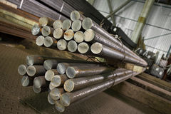 Stainless steel beams deposited in stacks Royalty Free Stock Image