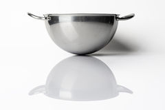 Stainless steel bowl from side on white with reflection Royalty Free Stock Photos