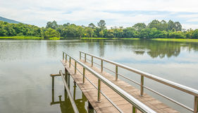 Stainless steel bridge or pier at lake Stock Photography