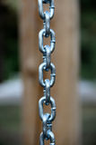 A stainless steel chain with soldered links. Closeup of a stainless steel chain with soldered links stock photo