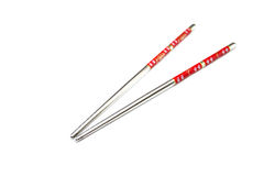 Stainless steel chopsticks with red pattern. Stock Images