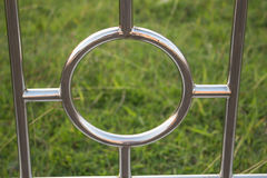 Stainless steel circle on a natural background Royalty Free Stock Image