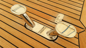 Stainless steel cleats with teak decking background Stock Image