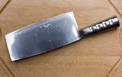 Stainless steel cleaver on a cutting board Stock Images