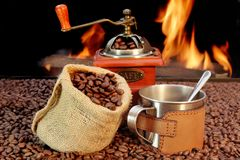 Stainless Steel Coffee Mug and old Grinder with beans Stock Photography