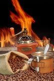 Stainless Steel Coffee Mug and old Grinder with beans Royalty Free Stock Photos