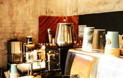 Stainless Steel Coffee Pot and Disposable Cups on Top of Counter Royalty Free Stock Photography