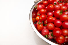 Stainless steel collander of fresh tomatoes. A stock photo of a stainless steel collander full of a variety of fresh, clean, healthy cherry tomatoes on a kitchen Stock Photography