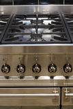 Stainless steel cooker. A stainless steel gas cooker, showing middle section stock image