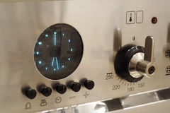 Stainless steel cooker. A stainless steel range cooker, detail of controls royalty free stock photos