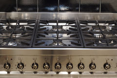 Stainless steel cooker. A stainless steel range cooker, six ring hob and controls royalty free stock images
