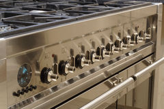 Stainless steel cooker. A stainless steel range cooker, showing control panel royalty free stock photos