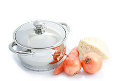 Stainless steel cooking pot and vegetables Stock Photos