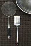 Stainless steel cooking utensils kitchenware and w Stock Photo