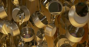 Stainless steel cookware. Hanging and dangling stock video footage