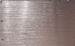 Stainless Steel copper finish screw framed background Stock Photo