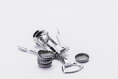 Stainless steel corkscrew with metal lids on white background Royalty Free Stock Photography