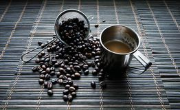 Cup of coffe with coffee beans royalty free stock photos