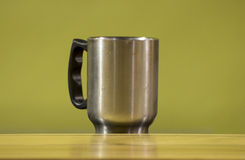 Stainless Steel Cup On Green Background Stock Image