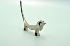 Stainless steel dog. Stainless steel model of a dog against a light blue background Royalty Free Stock Photography