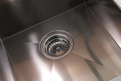 Stainless steel drain. Closeup on a stainless steel drain Stock Photography
