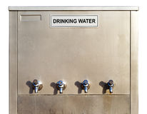 A stainless steel drinking water dispenser Royalty Free Stock Photos