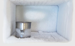 Stainless steel drinking water glass in freezer Stock Images