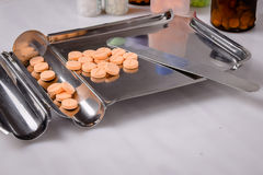 Stainless Steel drug Counting Tray and Spatula with medicine pills stock photography