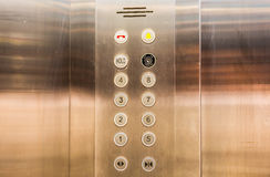 Stainless steel elevator panel push buttons. Royalty Free Stock Photo