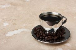 Stainless steel espresso cup on saucer Stock Images