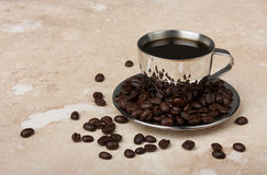 Stainless steel espresso cup with saucer Stock Image