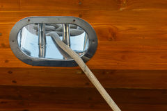 Stainless Steel Fairlead on a Wooden yacht Stock Photography