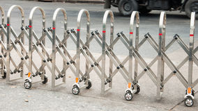 Stainless steel fence along the Many wheels. For moving traffic stock photos