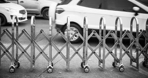 Stainless steel fence along the Many wheels. For moving traffic royalty free stock images