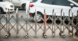 Stainless steel fence along the Many wheels. For moving traffic stock photo
