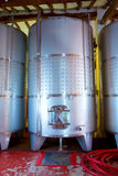 Stainless steel fermentation tanks vessels in winery Royalty Free Stock Photography