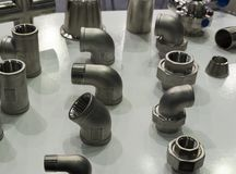Stainless steel Fittings for pipes stock photos
