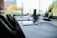 Stainless steel fork on dining table near window Stock Photo
