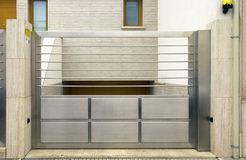 Stainless steel gate. Stainless steel external garage gate Stock Photography