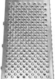 Stainless steel grater closeup. Royalty Free Stock Photography