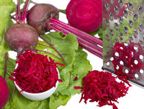 Stainless steel grater and grated beet. Stock Photo