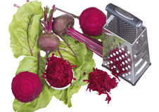 Stainless steel grater and grated beet. Stock Photography