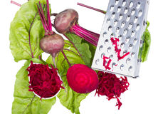 Stainless steel grater and grated beet. Royalty Free Stock Photography