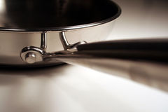Stainless Steel Handle. A close up of the handle of a stainless steel frying pan Royalty Free Stock Photos