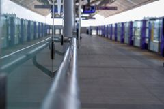 Stainless steel handrail in the electric train station royalty free stock photo