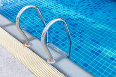 Stainless steel handrail stair of swimming pool Stock Image