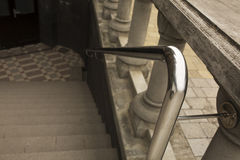Stainless steel handrails with the concrete staircase outdoor. In Lviv stock photos