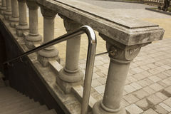 Stainless steel handrails with the plaster staircase. Outdoor stock photos