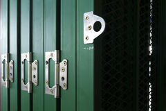 Stainless hinges on door. Stainless steel hinges on the main green door Royalty Free Stock Image
