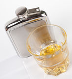 Stainless steel hip flask and whisky Stock Photography